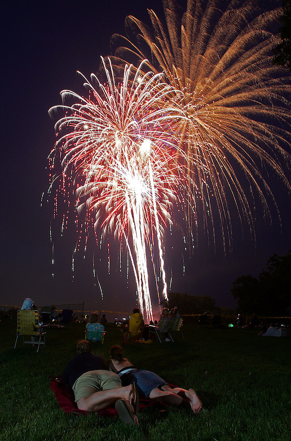 Fireworks lit up the night's sky over McIntire Park as thousands came out to enjoy the 4th of July celebration Tuesday in Charlottesville, Va. Photo//Andrew Shurtleff