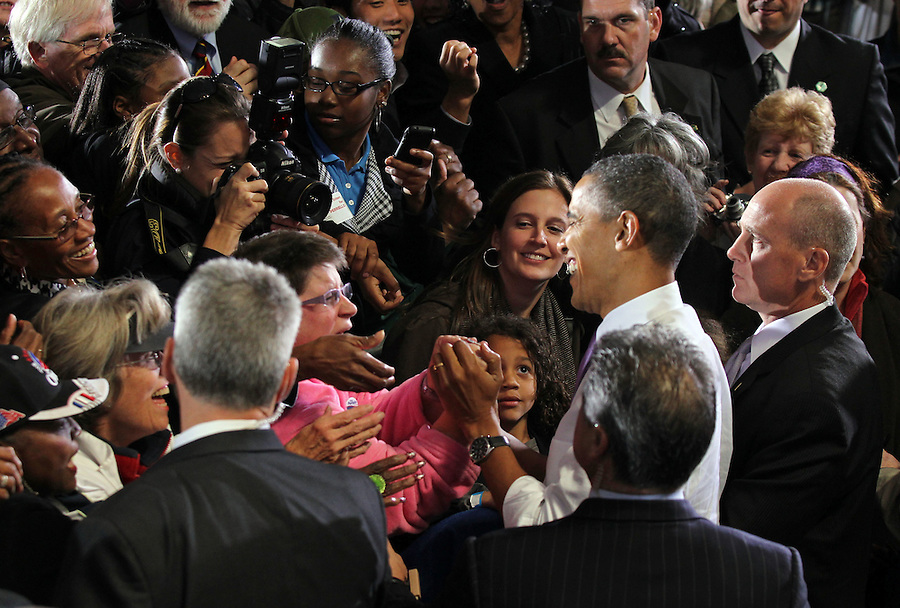 Oct 29, 2010. Oct 29, 2010. President Barack Obama shakes hands with the audience after a campaign rally for Virginia 5th District Representative Congressman Tom Perriello Friday at the Charlottesville Pavilion in downtown Charlottesville, Va. Photo/Andrew Shurtleff
