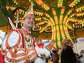 Düsseldorf, Germany. 15 February 2015. Prince Christian taking a ride on a children's carousel. Street carnival celebrations take place on Königsallee (Kö) in Düsseldorf ahead of the traditional Shrove Monday parade (Rosenmontagszug).