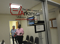 NWA Democrat-Gazette/FLIP PUTTHOFF <br /> Pattie Williams of Fayetteville (left) tours the Urban League of Arkansas office Friday Sept. 18 2015 with D'Andre Jones, a board member of the Urban League of Arkansas. The office is at the Center for Nonprofits in Springdale, 614 E. Emma Ave.