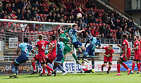 Goalkeeper Sam Sargeant of Leyton Orient punches clear of Will De Havilland of Wycombe Wanderers during the Sky Bet League 2 match between Leyton Orient and Wycombe Wanderers at the Matchroom Stadium, London, England on 1 April 2017. Photo by Andy Rowland.