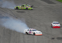 Feb 9, 2008; Daytona, FL, USA; ARCA RE/MAX Series driver Ed Kennedy (00) and Ryan Fischer (25) crash during the ARCA 200 at Daytona International Speedway. Mandatory Credit: Mark J. Rebilas-US PRESSWIRE