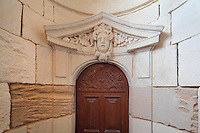 Pediment above a door in the King's Apartment, designed in 1664 under Colbert during the reign of King Louis XIV, on the first floor of the Phare de Cordouan or Cordouan Lighthouse, built 1584-1611 in Renaissance style by Louis de Foix, 1530-1604, French architect, located 7km at sea, near the mouth of the Gironde estuary, Aquitaine, France. This is the oldest lighthouse in France. There are 4 storeys, with keeper apartments and an entrance hall, King's apartments, chapel, secondary lantern and the lantern at the top at 68m. Parabolic lamps and lenses were added in the 18th and 19th centuries. The lighthouse is listed as a historic monument. Picture by Manuel Cohen