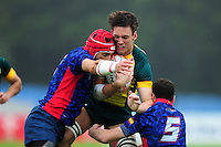 Lachlan Anderson of Australia takes on the Spain defence. FISU World University Championship Rugby Sevens Men's Semi Final between Australia and Spain on July 9, 2016 at the Swansea University International Sports Village in Swansea, Wales. Photo by: Patrick Khachfe / Onside Images