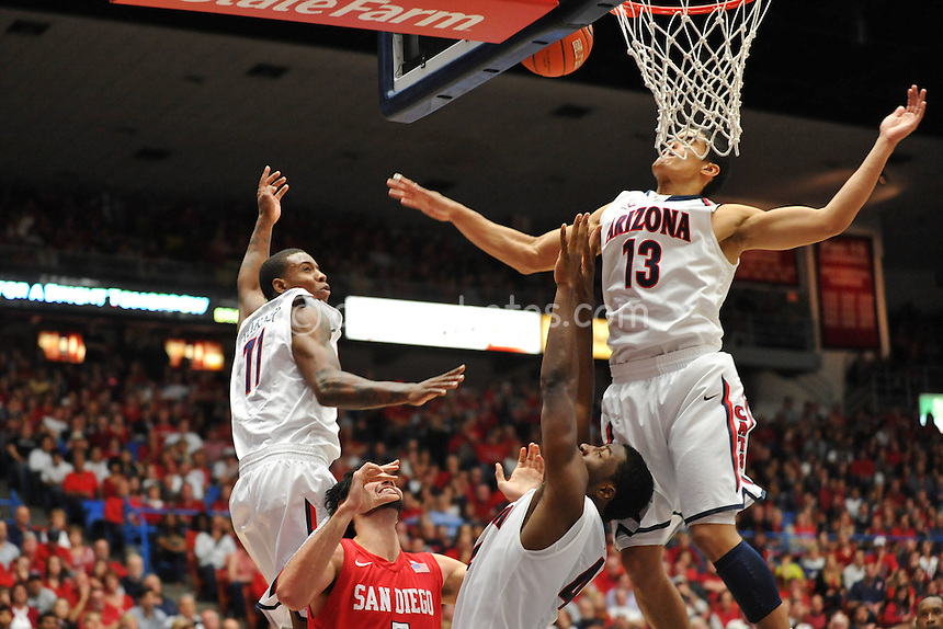 Nov 23, 2011; Tucson, AZ, USA; Arizona Wildcats guard Nick Johnson (13) blocks the shot of San Diego State Aztecs forward Garrett Green (5) in the second half of a game at the McKale Center.  The Aztecs won 61-57.  Mandatory Credit: Chris Morrison-US PRESSWIRE
