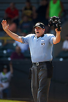 Umpire Matt Snodgrass calls a foul ball during a game between the Great Lakes Loons and Clinton LumberKings on August 16, 2015 at Ashford University Field in Clinton, Iowa.  Great Lakes defeated Clinton 3-2 in ten innings.  (Mike Janes/Four Seam Images)