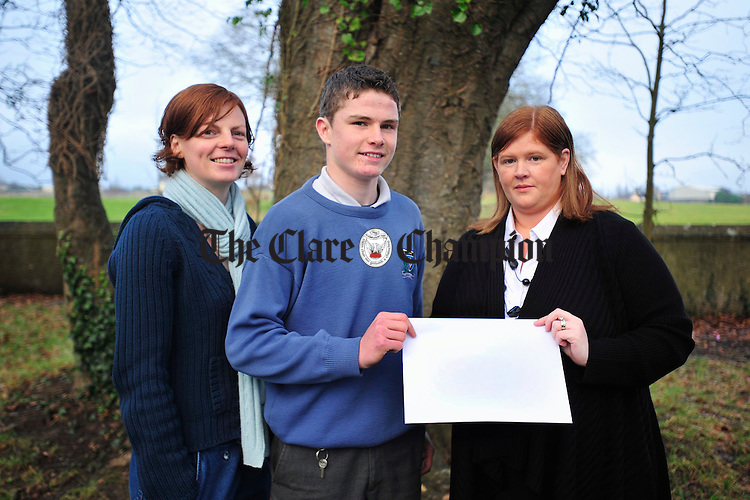Ms Geraldine Egan, right, presents Paul Flanagan from Ballyea and Shona Cahill of St Flannan's College with a cheque for Ä3,000 towards the St Flannan's Calcutta Youth Project, proceeds raised from the Ballyea Christmas Fair. Photograph by Declan Monaghan