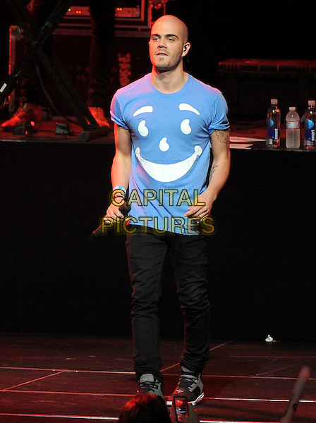 Max George of The Wanted.KIIS FM Jingle Ball Night 2 held at Nokia Live in Los Angeles, California, USA..3rd December 2012 .on stage in concert music gig performing live performance full length black jeans denim white t-shirt blue smiley face print .CAP/DVS.©DVS/Capital Pictures.
