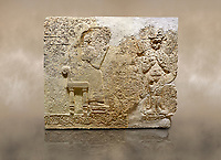 Photo of Hittite relief sculpted orthostat stone panel  of Long Wall Limestone, Karkamıs, (Kargamıs), Carchemish (Karkemish), 900-700 BC. Anatolian Civilisations Museum.<br /> <br />  The hieroglyphics reads; &quot;I am Win-a-tis, beloved wife of my Lord Suhi, wherever and whenever my husband honours his name, he will honour my name as well with favours&quot;. Underneath, there are two goddess figures, one is naked with a horned head, holding her breasts with her hands. Her genitalia is indicated by a triangle. <br /> <br /> On a brown art background.