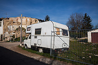 Onna, a few Kilometres from L'Aquila, is a village that was almost completely erased by the earthquake of April 6, 2009.  85% of its old buildings went destroyed, killing 40. <br /> A camper parked in front of a collapsed house. It was probably used by displaced residents of Onna. Onna, Italy. April 10, 2015