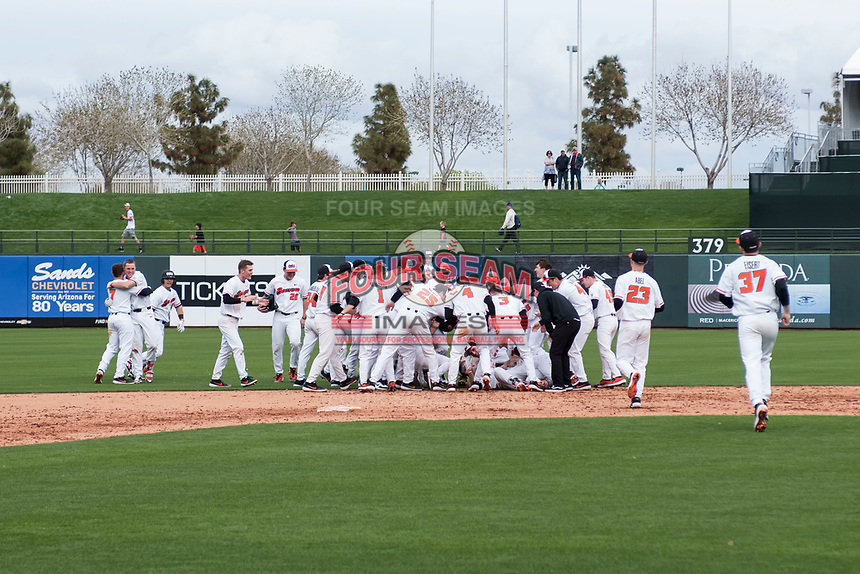 The Oregon State Beavers celebrate after Greg Fuchs's (36) walk-off hit against the New Mexico Lobos on February 15, 2019 at Surprise Stadium in Surprise, Arizona. Oregon State defeated New Mexico 6-5. (Zachary Lucy/Four Seam Images)