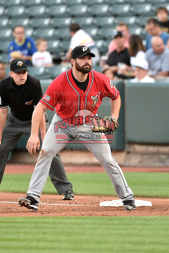 Cody Decker (14) of the El Paso Chihuahuas on defense against the Salt Lake Bees in Pacific Coast League action at Smith's Ballpark on August 7, 2014 in Salt Lake City, Utah.  (Stephen Smith/Four Seam Images)