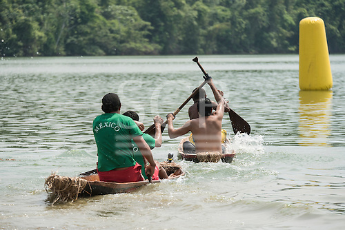 The Mexican team close in on another canoe as they near the marker buoy during the canoeing event at the International Indigenous Games, in the city of Palmas, Tocantins State, Brazil. Photo © Sue Cunningham, pictures@scphotographic.com 30th October 2015
