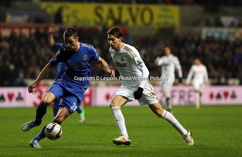 Wednesday 23 January 2013<br /> Pictured L-R Gary Cahill of Chelsea against Michu of Swansea: <br /> Re: Capital One Cup semi-final second leg, Swansea City FC v Chelsea at the Liberty Stadium, south Wales.