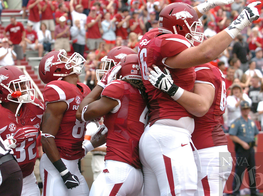 NWA Media/ANDY SHUPE - Arkansas receiver Keon Hatcher, center, celebrates a touchdown on the first play of the game during the first quarter against Nicholls Saturday, Sept. 6, 2014, at Razorback Stadium in Fayetteville