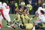 Annapolis, MD - October 8, 2016: Navy Midshipmen fullback Shawn White (31) runs the ball during game between Houston and Navy at  Navy-Marine Corps Memorial Stadium in Annapolis, MD.   (Photo by Elliott Brown/Media Images International)