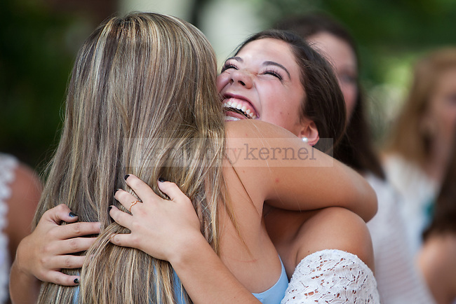 Taylor Merrick, right, hugs her new Kappa Delta sister Maddie Hammann during sorority bid day in Lexington, Ky. on Friday, August 21, 2015. Photo by Adam Pennavaria | Staff