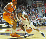 "Mississippi's Jarvis Summers (32) drives against Tennessee's Jarnell Stokes (5)  at the C.M. ""Tad"" Smith Coliseum on Thursday, January 24, 2013. Mississippi won 62-56 to improve to 5-0 in the SEC. (AP Photo/Oxford Eagle, Bruce Newman)"