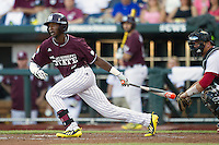 Mississippi State outfielder Demarcus Henderson (2) follows through on his swing against the Indiana Hoosiers during Game 6 of the 2013 Men's College World Series on June 17, 2013 at TD Ameritrade Park in Omaha, Nebraska. The Bulldogs defeated Hoosiers 5-4. (Andrew Woolley/Four Seam Images)