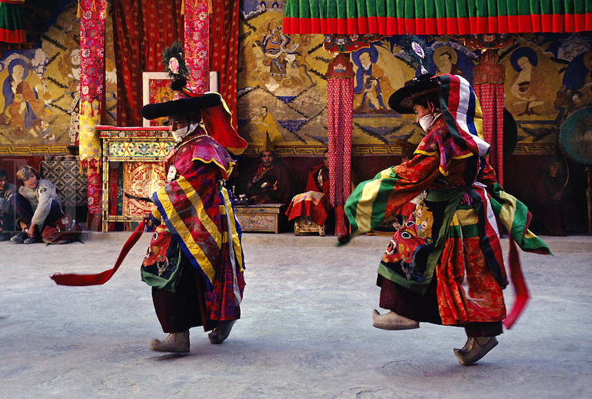 TANTRIC DANCERS in silk costumes, with scarf to prevent inhaling living beings, TIKSE Monastery Masked Dances - LADAKH, INDIA