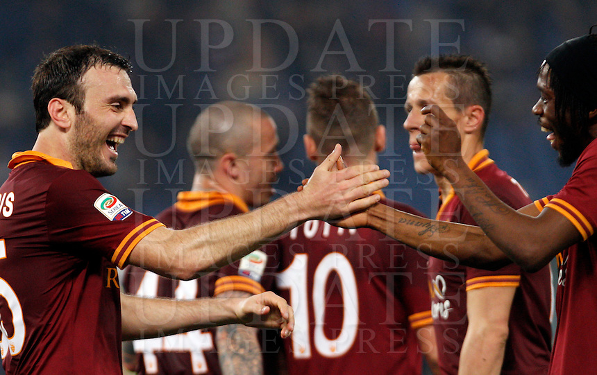 Calcio, Serie A: Roma vs Udinese. Roma, stadio Olimpico, 17 marzo 2014.<br /> AS Roma defender Vasilis Torosidis, of Greece, left, celebrates with teammate Gervinho  of Ivory Coast, after scoring after scoring during the Italian Serie A football match between AS Roma and Udinese at Rome's Olympic stadium, 17 March 2014.<br /> UPDATE IMAGES PRESS/Riccardo De Luca