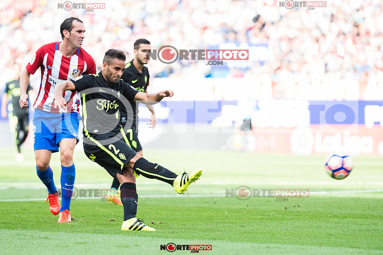 Atletico de Madrid's player Diego Godín and Sporting de Gijon's Douglas and Victor R. during a match of La Liga Santander at Vicente Calderon Stadium in Madrid. September 17, Spain. 2016. (ALTERPHOTOS/BorjaB.Hojas) /NORTEPHOTO
