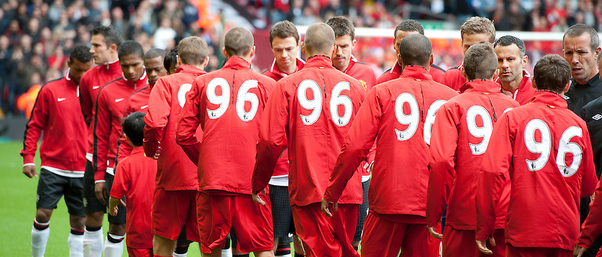 Liverpool players wear tracksuits in tribute to the ninetysix people who dies in the 1989 Hillsborough disaster as they shake hands with their Manchester United rivals in the pre-match ritual..Football - Barclays Premiership - Liverpool v Manchester United - Sunday 23rd September 2012 - Anfield - Liverpool..