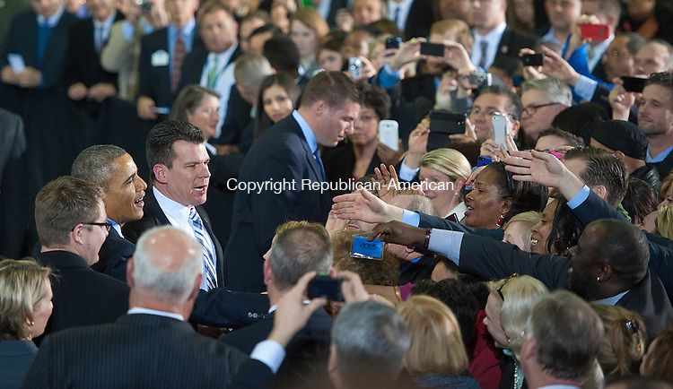 NEW BRITAIN, CT-030514JS03--President Barack Obama greets guests after speaking of the need to raise the minimum wage during visit to Connecticut State University in New Britain on Wednesday.  The President was  joined by Dannel P. Malloy  of Connecticut, Governor Deval Patrick of the Commonwealth of Massachusetts, Governor Lincoln D. Chafee of Rhode Island, Governor Peter Shumlin of Vermont and Secretary of Labor Thomas E. Perez.<br /> Jim Shannon Republican-American