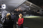 A television reporter reads news of the death of Barack Obama's grandmother off her Blackberry at the site of Obama's election rally in Grant Park early in the morning on election day in Chicago, Illinois on November 4, 2008.
