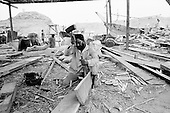 Sur, Oman<br /> July 2001<br /> <br /> Dhow builders chisel each piece of the boat by hand.