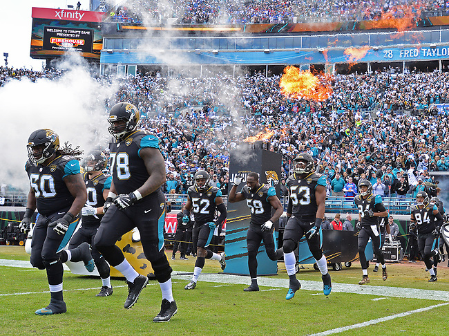 Jacksonville Jaguars players enter the field before kickoff against the Buffalo Bills in a NFL Wildcard Playoff game Sunday, January 7, 2018 in Jacksonville, Fl.  (Rick Wilson/Jacksonville Jaguars)