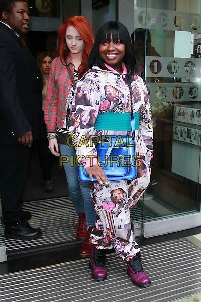 "Janet Devlin & Misha ""Misha B"" Bryan at BBC Radio 1, London, England..November 21st, 2011.X Factor full length black purple boots white pink ghetto blaster satchel bag purse green belt jumpsuit print side.CAP/HIL.©John Hillcoat/Capital Pictures ."