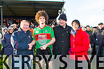 Beale's Neilus Mulvihill is presented with the  man of the match by Greg Ryan with Billy Enright (Chairman of North Kerry ) and Ooagh O'Connor  at the Bernard O'Callaghan Memorial Senior Football Championship final last Saturday Beale V Listowel Emmets