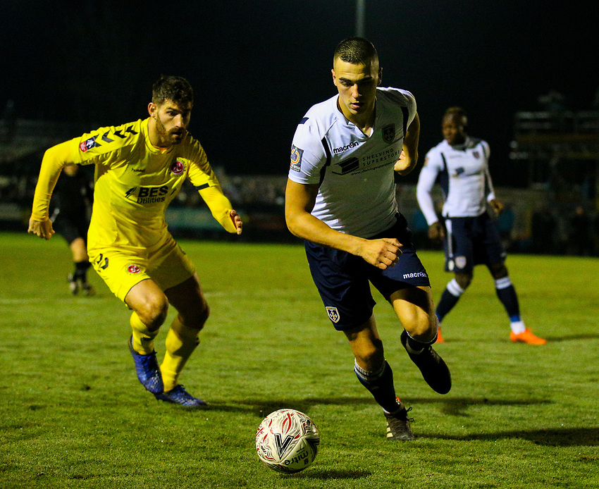 Guiseley's William Wells turn away from Fleetwood Town's Ched Evans<br /> <br /> Photographer Alex Dodd/CameraSport<br /> <br /> The Emirates FA Cup Second Round - Guiseley v Fleetwood Town - Monday 3rd December 2018 - Nethermoor Park - Guiseley<br />  <br /> World Copyright © 2018 CameraSport. All rights reserved. 43 Linden Ave. Countesthorpe. Leicester. England. LE8 5PG - Tel: +44 (0) 116 277 4147 - admin@camerasport.com - www.camerasport.com