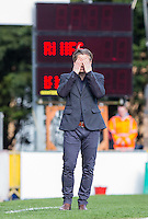 Wycombe Wanderers Manager Gareth Ainsworth covers his eyes during the Sky Bet League 2 match between Wycombe Wanderers and Barnet at Adams Park, High Wycombe, England on 16 April 2016. Photo by Andy Rowland.