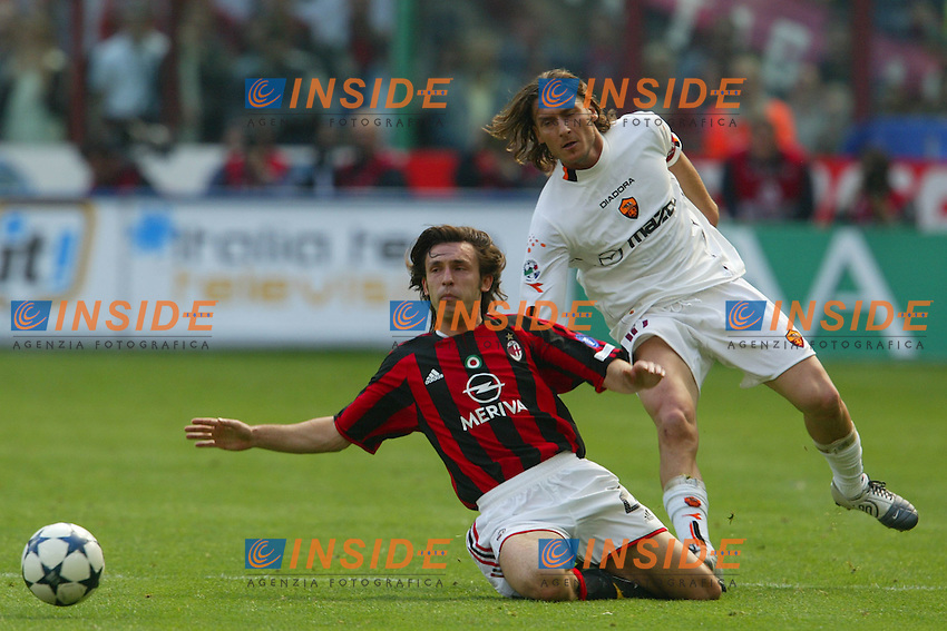 Milano 2/5/2004 Campionato Italiano Serie A - Matchday 32<br /> Milan Roma 1-0 <br /> Milan Campione d'Italia - Milan wins italian championship <br /> Andrea Pirlo (Milan) e Francesco Totti (Roma)