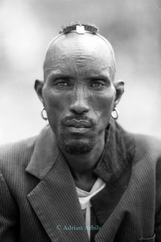 A Turkana man in a traditional village nr Kakuma, Northern Kenya.