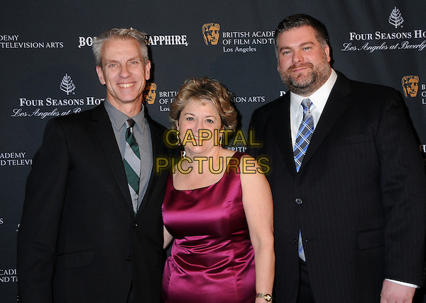 CHRIS SANDERS, BONNIE ARNOLD & DEAN DeBLOIS.17th Annual BAFTA Los Angeles Awards Season Tea Party held at the Four Seasons Hotel, Beverly Hills, California, USA, 15th January 2011..half length black grey gray suit tie purple silk satin pink dress .CAP/ADM/BP.©Byron Purvis/AdMedia/Capital Pictures.