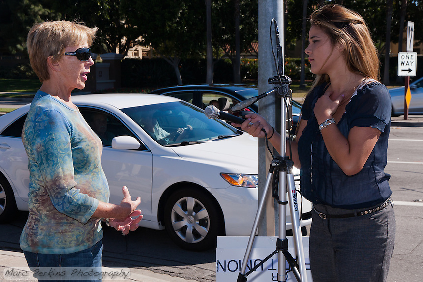 A woman is interviewed by a reporter at the Occupy Orange County, Irvine camp on November 5.