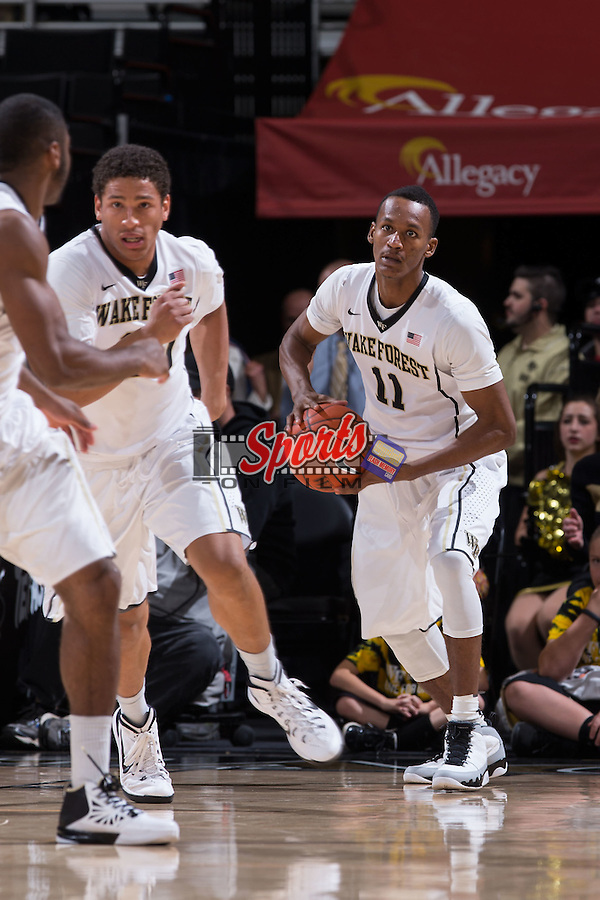 Greg McClinton (11) of the Wake Forest Demon Deacons grabs a rebound during first half action against the Minnesota Golden Gophers at the LJVM Coliseum on December 2, 2014 in Winston-Salem, North Carolina.  The Golden Gophers defeated the Demon Deacons 84-69. (Brian Westerholt/Sports On Film)