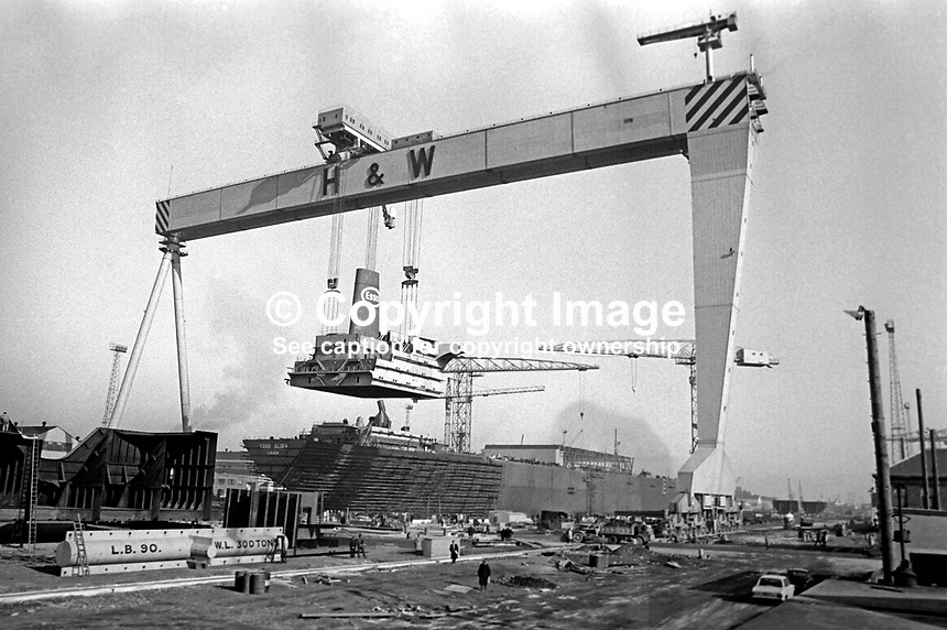 Esso Ulidia under construction at the Belfast, N Ireland shipyard of Harland &amp; Wolff. The giant crane &quot;Goliath&quot; is manoevering the upper decks superstructure into place. 5th March 1970. It went to the breakers yard in 1983. 197003050095a<br /> <br /> Copyright Image from Victor Patterson, 54 Dorchester Park, Belfast, UK, BT9 6RJ<br /> <br /> t: +44 28 9066 1296<br /> m: +44 7802 353836<br /> vm +44 20 8816 7153<br /> <br /> e1: victorpatterson@me.com<br /> e2: victorpatterson@gmail.com<br /> <br /> www.victorpatterson.com<br /> <br /> IMPORTANT: Please see my Terms and Conditions of Use at www.victorpatterson.com