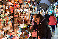 Tourists shopping for lamps inside The Grand Bazaar, Kapalicarsi, great market in Beyazi, Istanbul, Republic of Turkey