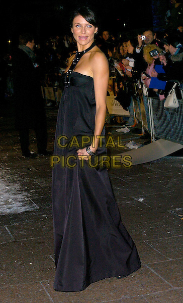"CAMERON DIAZ .At the UK Film Premiere of ""The Holiday"", Odeon Leicester Square, London, UK..December 5th 2006.full length long black halterneck dress.CAP/CAN.©Can Nguyen/Capital Pictures"