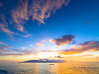 A brilliant Hawaiian sky as the sun sets behind Lana'i, as seen from Ka'anapali Beach, Maui.