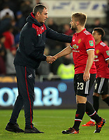 (L-R) Swansea manager Paul Clement shakes hands with Luke Shaw of Manchester United during the Carabao Cup Fourth Round match between Swansea City and Manchester United at The Liberty Stadium, Swansea, Wales, UK. Tuesday 24 October 2017