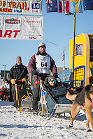 Robert Bundtzen and team leave the ceremonial start line at 4th Avenue and D street in downtown Anchorage during the 2014 Iditarod race.<br /> Photo by Jim R. Kohl/IditarodPhotos.com