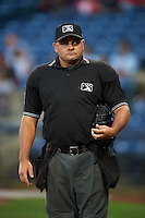 Umpire Jeremy Riggs during a game between the Pensacola Blue Wahoos and Mississippi Braves on May 27, 2015 at Trustmark Park in Pearl, Mississippi.  Pensacola defeated Mississippi 7-5 in fourteen innings.  (Mike Janes/Four Seam Images)