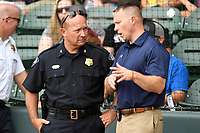 Greenville Police Chief Ken Miller, left, and Greenville County Sheriff Will Lewis talk before a game between the Hickory Crawdads and Greenville Drive on Sunday, July 16, 2017, at Fluor Field at the West End in Greenville, South Carolina. It was First Responders Day. Hickory won, 3-1. (Tom Priddy/Four Seam Images)