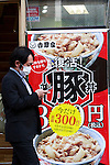 A man walks in front of a Yoshinoya restaurant on April 6 in Shinjuku, Tokyo. Yoshinoya Holdings Co. Ltd., announced on Wednesday the re-introduction on its butadon menus (pork-on-rice bowl) starting April 6, more than four years after the dishes were removed from its menu. The butadon, introduced in March 2004 as an alternative to Gyudon (beef-on-rice bowl,) was removed from the menu on December 2011, when Gyudon sales resumed after the end of the embargo on US beef following the discovery of the country's first mad cow disease case in 2004. (Photo by Rodrigo Reyes Marin/AFLO)