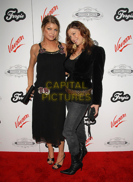 FERGIE & DANA FERGUSON.Fergie's Birthday Party at Citizen Smith Nightclub in Hollywood , California, USA..March 28th, 2006.Ref: DVS.Stacey Ferguson Black Eyed Peas full length sisters siblings family black dress top denim jeans.www.capitalpictures.com.sales@capitalpictures.com.Supplied By Capital PIctures.